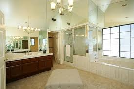 modern master bathroom with chandelier amp large ceramic tile in master bathrooms with walk in showers