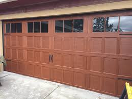 Red siding with almond garage door and trim by Wayne Dalton Garage ...