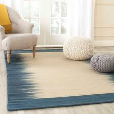 cozy sitting room with flat woven off white tribal jute wool rug photo 1 of