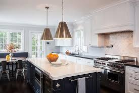 blue kitchen island with white quartz countertop