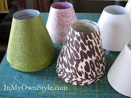 Stacked-Lamp-Shade-Covers How to make a basic lamp shade base with  posterboard and change out covers made out of scrapbook paper. Make  multiple sets!