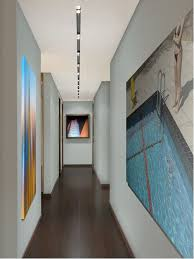 inspiration for a contemporary dark wood floor hallway remodel in miami with gray walls