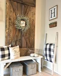 a whitewashed wooden bench and a repurposed bard door as a wall decoration