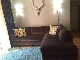sofia vergara 2 piece gray sectional sofa chaise nailhead trim we bought at