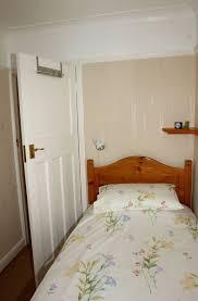 pleasant door model plus simple hook on top part in tiny bedroom ideas with single bed
