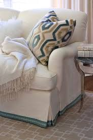 love the accent with the fabric tape along the bottom would love to add something like this to one of the chairs loving the tape trim on sofa skirt