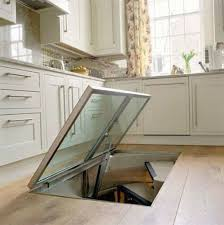 This Man Put A Secret Window On His Kitchen Floor. The Reason? GENIUS!