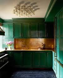 dark green painted kitchen cabinets. Kelly Wearstler Interior Design Living Room - Cameron Diaz Manhattan Apartment ELLE DECOR, Green Kitchen Cabinets With Gold Trim, Brass Hardware, Dark Painted