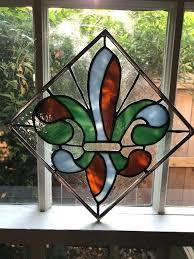 fleur de lis stained glass image 0 fleur de lis stained glass lit pedestal