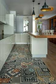 Vintage or hand painted concrete tiles for an all white sleek kitchen.