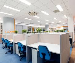 fluorescent light fixtures in an office with cubicles