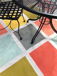 this weekend s diy a rug made from a canvas drop cloth painters tape and seven diffe colors of paint all in those little tester sizes from home