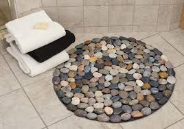 View in gallery Round bath mat with different colored pebbles