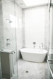Walk in shower with a bathtub in a Master Bathroom by House Beautiful Next  Wave interior