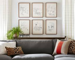 Along the same lines as the gallery wall, adding in a triptych, or set of 3 canvases, will help you fill in a large wall. Hanging Wall Art The Complete Guide How To Decorate