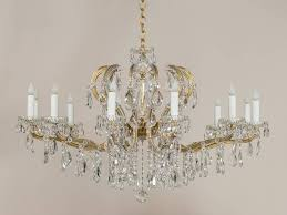 the elegant balance between the width and the height of this vintage crystal chandelier give it