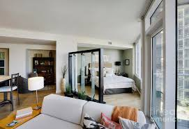Bedroom Area And Living Room In Upscale Studio Apartment Photograph