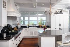 traditional kitchen with angola black granite counters curved breakfast bar island chandelier and ocean