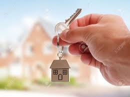 house key. Brilliant Key Holding House Keys On Shaped Keychain In Front Of A New Home Stock  Photo  For House Key E