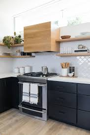 Mid Century Modern Home With Black Cabinets White Countertops