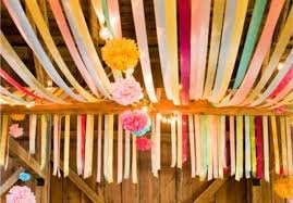 Loop streamers over ceiling beams to create a colorful ceiling. Don't have  ceiling beams to work with? Hook streamers to a center pole in tent and  have them ...