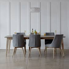 the abbey chair defines understated chic with its elegant contoured seat and back available in a choice of subtle washed grey oak and stained walnut