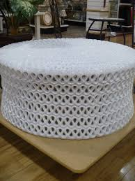 furniture white acrylic round ottoman coffee table with square cream wooden tray on laminate flooring
