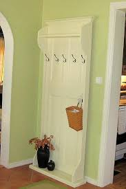 old door repurposed to a hall tree