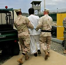 supreme court new ruling could delay start of guantanamo trials a detainee is being escorted onto the premises