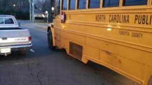 Man cited after pickup truck hits school bus in Winston-Salem ...