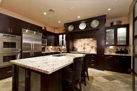 dark cabinets with light granite countertops image and