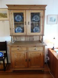 pine kitchen dresser with two glass doors above two drawers and doors with a pull out work shelf original locks and key holland circa 1880