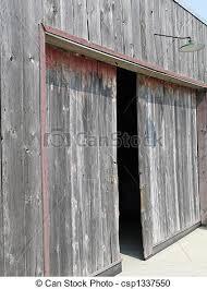 old wooden barn with open doors csp1337550