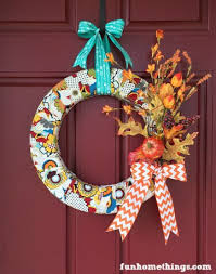 Fabric and ribbon-wrapped wreaths are the perfect pop of color to your  porch and they require very little skill. If you can wrap fabric around a  styrofoam ...