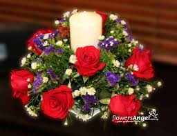 ta055 075 12 red roses round table arrangement with scented candle in the middle