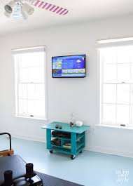 a mounted flat screen tv on a wall in a