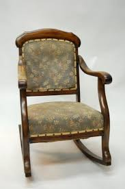 ... old upholstered rocking chair ...