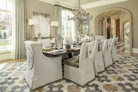 traditional dining room with wood grey glaze table lamp hardwood floors belgian wingback slipcovered