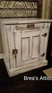 White Distressed White Clad Icebox side table. These are a cool funky redo,  snatch