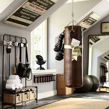 this loft conversion has been turned into a timeless and classic training room using everyday home furnishings a rattan rug makes exercise comfortable workout storage ideas25 storage