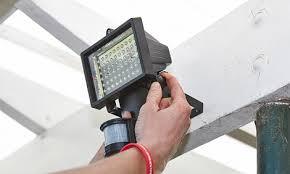 person attaching sensor light