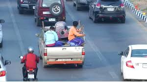 People are not allowed to ride on the back of pickup trucks: Land ...