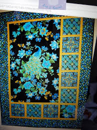 peacock panel quilt instructions - Quilters Club of America & I am not finding it online. I don't remember the official name. I did find  a photo of it. Can anyone tell me how to replace my lost pattern? Adamdwight.com