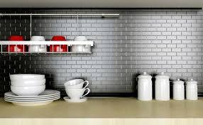 kitchen backsplash stainless steel tiles: metal backsplash with gray grout lines