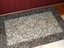 grey white tan area rug and s