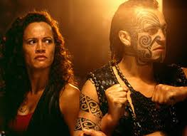 oflc student once were warriors  a still image from the film of beth looking angrily at a tattoo d man