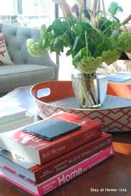 stacking books on the coffee table
