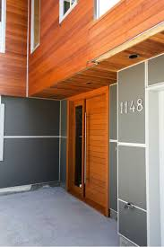 this home contrasts smooth fiber cement panels with a natural looking wood grain on the horizontal lap siding which has a natural looking variation in