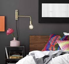 bedroom swing arm wall sconces. Brass Swing Arm Wall Lamp Installed In The Bedroom With Grey Walls : Amazing Sconces