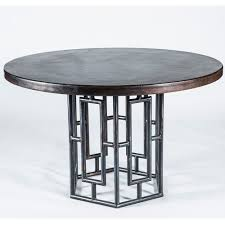 rincon round dark brown copper top dining table base shown in fire
